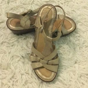 Metallic gold Born wedge sandals in size 7/38